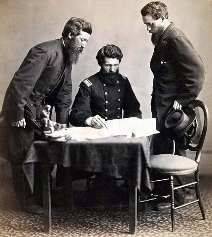 Staged photograph, ca. 1865, of Lt. Baker, Col. Baker, and Lt. Col. Conger